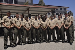 Marine volunteer Devil Pups instructors gather for a group photograph during the the Devil Pups graduation ceremony on Camp Pendleton's 52 Area Parade Deck, July 28.