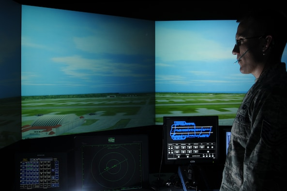 ANDERSEN AIR FORCE BASE, Guam – Tech. Sgt. Chad Thompson, 36th Operations Support Squadron tower watch supervisor, watches over a virtual layout of Andersen Air Force Base's flightline July 20. The virtual layout is within a virtual air traffic control tower simulation that allows controllers to hone in on the skills required to control a busy flightline. (U.S. Air Force photo by Senior Airman Carlin Leslie/Released)