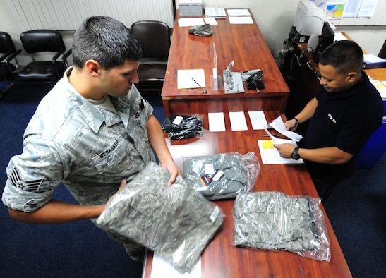 ANDERSEN AIR FORCE BASE, Guam— Staff Sgt. Kurtis Strasser, 734th Air Mobility Squadron unit deployment manager, receives an order from Duane Chargualaf, 36th Logistics Readiness Squadron individual equipment unit warehouse specialist, July 20. Approximately 80 to 100 individual issue requests are filled by IEU daily. (U.S Air Force photo by Senior Airman Benjamin Wiseman/Released)