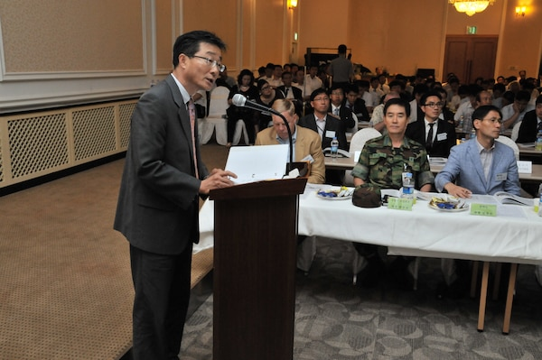 Chris Kim, Chief of the U.S. Army Corps of Engineers, Far East District Technical Review Branch, briefed attendees of the Local Construction Materials Conference on the role of USACE and FED July 27. (Photo by Patrick Bray)