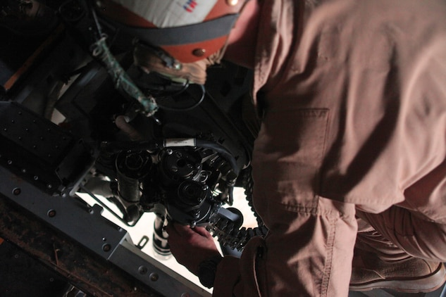 Sgt. Ryan Alt, a crew chief with Marine Medium Tiltrotor Squadron 261 (Reinforced), 24th Marine Expeditionary Unit, and Houston, Texas native, mounts a Defensive Weapon System through the aft cargo hole of an MV-22 Osprey in Camp Buehring, Kuwait, July 29, 2012. VMM-261 (Rein) is in Kuwait as part of a 24th MEU sustainment training package. The 24th MEU is deployed with the Iwo Jima Amphibious Ready Group as a U.S. Central Command theater reserve force providing support for maritime security operations and theater security cooperation efforts in the U.S. 5th Fleet area of responsibility.