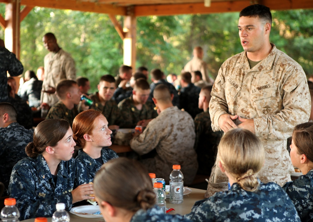 A group of midshipmen listen intently as a Marine officer discusses various aspects of the military with them during a dinner and military occupational specialty mixer aboard Marine Corps Air Station New River July 26. The midshipmen enjoyed a relaxing dinner after a long week of training aboard Marine Corps Base Camp Lejeune.