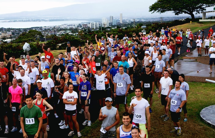 More than 210 military and civilian competitors shuffle into position before the start of the annual Camp Smith 5K Grueler here, July 28. The scenic starting point gave the runners a bird's-eye view of Pearl Harbor, Honolulu and a vast portion of southern Oahu. The event gave Marines in different work sections a chance to bond, as well as build esprit de corps, said Capt. Greg Wagner, commander of Headquarters Company, Headquarters and Service Battalion, U.S. Marine Corps Forces, Pacific.  The large turnout allowed for some of the proceeds to offset ticket prices for junior service members during MarForPac's Marine Corps birthday ball in November.