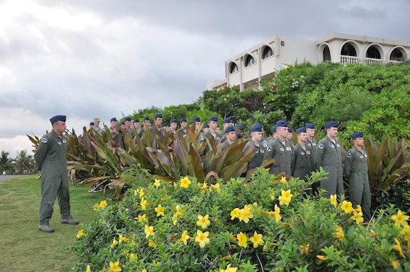 Members of the 69th Expeditionary Bomb Squadron stand in formation for the