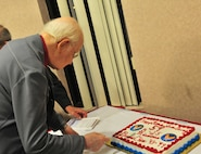 Ernie Shuey, retired military pilot, cuts his birthday cake during a meeting for the Order of Daedalians at Cannon Air Force Base, N.M., July 26, 2012. The Order of Daedalians was created in 1933 for pilots who flew during World War l and has since grown to include any rated pilot who served in the military. (U.S. Air Force photo/Airman 1st Class Xavier Lockley)