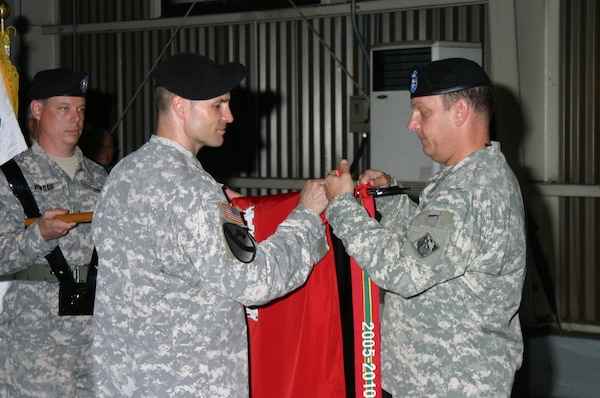 Col. Blair A. Schantz, U.S. Army Corps of Engineers, Far East District Commander, hangs the Army Superior Unit streamer on the District colors during a ceremony June 29. USACE was awarded the streamer for its mission execution during fiscal years 2006-2010. (Photo by O, Sang-song)