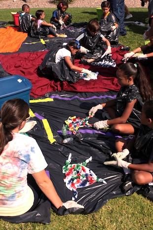 Children create tie dye t-shirts during day one of Camp Camo at the Paige Fieldhouse, July 30. Camp Camo is a four-day camp where young children ages seven to 11 learn about nutrition, exercise and how to be healthy during the summer.