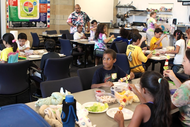 Children at Camp Camo make healthy shish kabobs for lunch in a classroom at the Paige Fieldhouse, July 30. Throughout the day the children also learn how to make healthy snacks they can make on their own at home.
