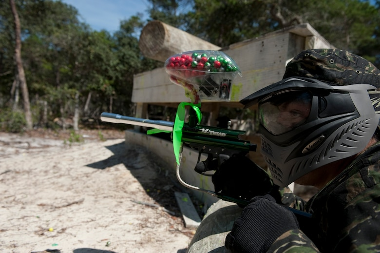 U.S. Air Force Senior Airman Jesus Torres, aerospace propulsion journeyman from 1st Special Operations Component Maintenance Squadron, scans the horizon at the paintball field, Hurlburt Field, Fla., July 27, 2012. While the Airmen dominated the chiefs with their superior numbers in the initial match of attack and defend, many said they appreciated the participation of the chiefs and first sergeants.  (U.S. Air Force Photo/Airman 1st Class Hayden K. Hyatt)