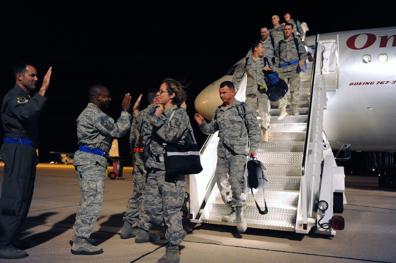 Airmen are greeted by Dyess leadership July 25, 2012, after returning from a six-month deployment to Southwest Asia. More than 400 Airmen deployed in support of Operation Enduring Freedom. The deployment marked the largest B-1 Bomber deployment of aircraft and personnel in the last 10 years. (U.S. Air Force photo by Senior Airman Robert Hicks/Released)