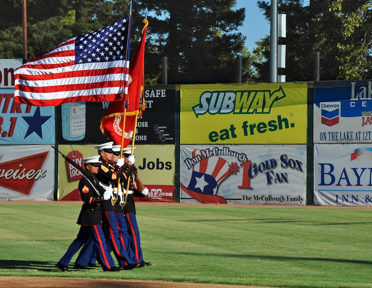 Members of a U.S. Marine Corps color guard perform during the opening ceremonies of Military Appreciation Night at a Marysville Gold Sox game at Appeal-Democrat Park, Marysville, Calif., July 29, 2012. The color guard was from a reserve unit in Sacramento. (U.S. Air Force photo by Staff Sgt. Robert M. Trujillo)