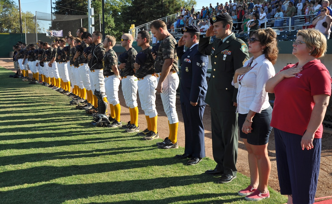Blue Star Moms, servicemen and Gold Sox Baseball players pay their respects during the national anthem at a military appreciation game at Appeal-Democrat Park, Marysville, Calif., July 29, 2012. BSM is a non-profit organization for mothers and fathers of children serving or have served in the military. (U.S. Air Force photo by Staff Sgt. Robert M. Trujillo)