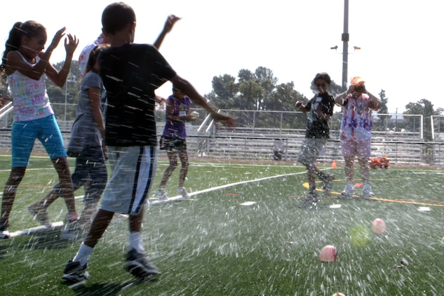 The water balloons toss is one of the activities the children participate in at Camp Camo at the Paige Fieldhouse, July 31. Camp Camo runs one week a year, Monday through Thursday from 9 a.m. to 12:30 p.m.