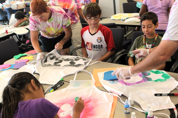 The children at Camp Camo design and create their own aprons in the classroom at the Paige Fieldhouse, July 31. A few other activities the children participate in are a water balloon toss, growing a plant, making a scrapbook and making their own healthy snacks and lunches.