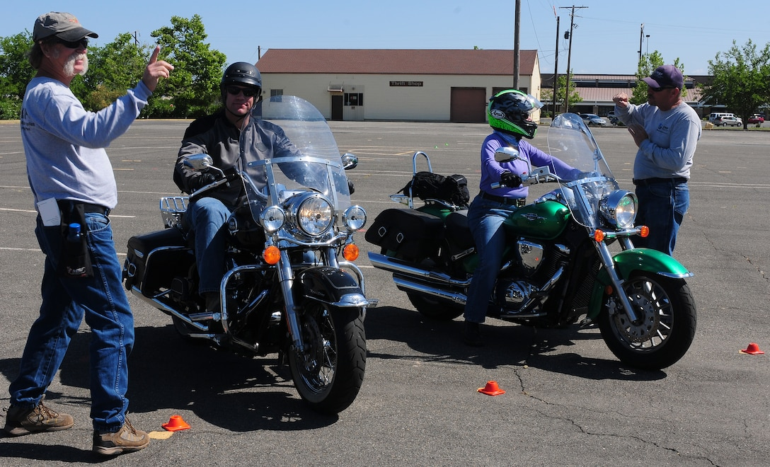 Motorcycle Safety Foundation certified rider coaches Kevin Pickerel (left) and Patrick Geronimi (right) give safety instructions to students of Basic Riders Course II at Beale Air Force Base, May 23, 2012.  The course designed by the MSF for riders who already have basic skills.  (U.S. Air Force photo by Senior Airman Allen Pollard/Released)