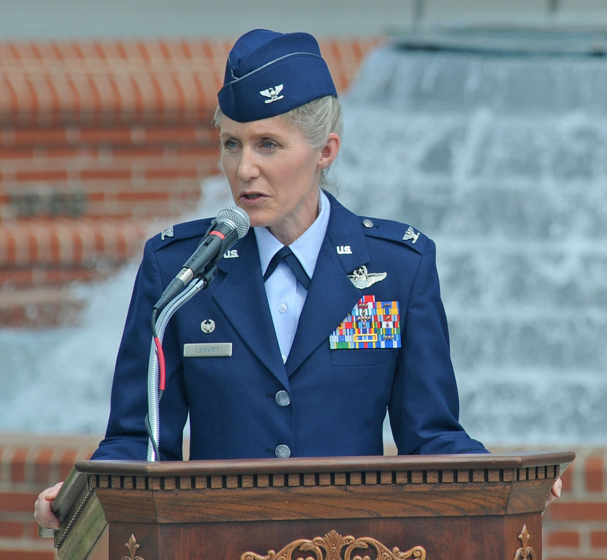 U.S. Air Force Col. Jeannie Leavitt speaks to the crowd during the wing change of command ceremony on Seymour Johnson Air Force Base, N.C., June 1, 2012. Leavitt is the first female to command an Air Force fighter wing. Since becoming the first mission-qualified female fighter pilot, she has logged more than 2,500 hours in the F-15E Strike Eagle. Leavitt is the 4th Fighter Wing commander.  (U.S. Air Force photo/Tech. Sgt. Colette Graham/Released)