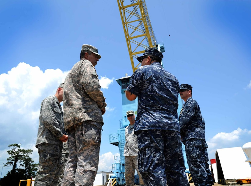 Army Lt. Gen. Vincent Brooks, Third Army commanding general, is briefed by Chief Warrant Officer 3 John Wilson, 628th Logistics Readiness Squadron, at Wharf Alpha May 23, 2012 at Joint Base Charleston – Weapons Station. Brooks visited JB Charleston to get a first-hand look at the military functions that are unique to this base. (U.S. Air Force photo/Airman 1st Class Ashlee Galloway)