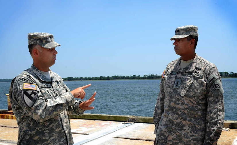 Army Lt. Gen. Vincent Brooks, Third Army commanding general, is briefed by Lt. Col. Andy Dawson, 841st Transportation Battalion Operations commander, at the Transportation Command Dock May 23, 2012 at Joint Base Charleston – Weapons Station. Brooks visited JB Charleston to get a first-hand look at the military functions that are unique to this base. (U.S. Air Force photo/Airman 1st Class Ashlee Galloway)