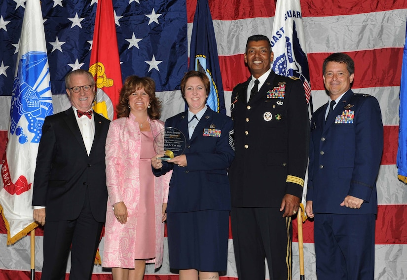 Peter Wertimer, Charleston Chamber of Military Policy council chairman, Julie Gerthoffer, Charleston Chamber of Military Relations Committee and U.S. Army Lt. Gen. Vincent Brooks, Third Army commanding general, present Senior Master Sgt. Michele Summers, 315th Airlift Wing, the 'Reservists of the Year' award, alongside her commanding officer, Col. Russell Finger, 315th Airlift Wing commander, during 'Salute to the Military' May 23, 2012 at the North Charleston Convention Center, S.C. This is the eighth year the Charleston Metro Chamber of Commerce recognized the local active-duty, reserve, and civilian personnel for their community service above and beyond their call of duty. (U.S. Air Force photo/Airman 1st Class Ashlee Galloway)