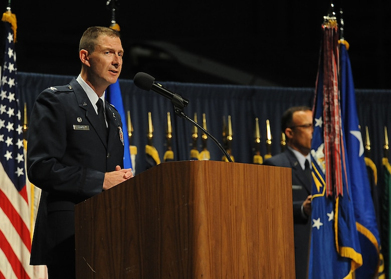 WRIGHT-PATTERSON AFB, Ohio -- Col. Aaron M. Prupas addressed family, friends and members of the National Air and Space Center after assuming command of NASIC during a ceremony held at the National Museum of the United States Air Force May 30. During the ceremony, Col. Kathleen C. Sakura relinquished command of NASIC and later retired from the Air Force following 24 years of service. Maj. Gen. Robert P. Otto, commander of the Air Force Intelligence, Surveillance and Reconnaissance Agency, Lackland AFB, Texas, presided over the event. (U.S. Air Force photo by Staff Sgt. Veronica Pierce)