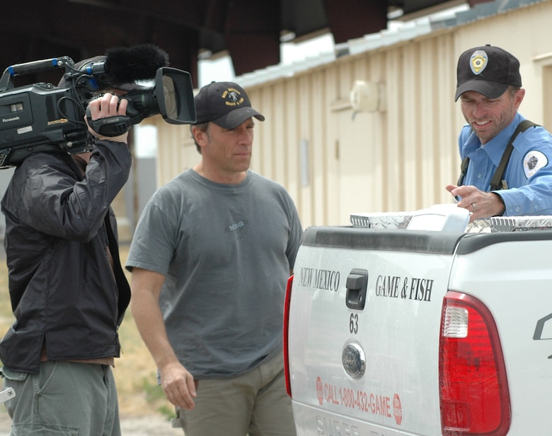 "Mike Rowe, star of ""Dirty Jobs,"" and Shawn Denny, southeast area fisheries manager with New Mexico Department of Game and Fish, discuss fish squeezing and prepare to board the boats to capture female fish for their eggs."