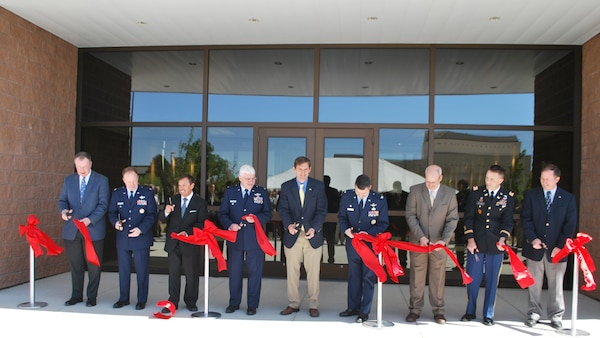Included in the ribbon-cutting (L to R): Mr. Donald Greenwood, president of construction, Burns & McDonnell Corporation; Lt. Col. David Hornyak, vice commander, 377th Air Base Wing; Mr. John Garcia, chairman of the Kirtland Partnership Committee; Col. Daniel Morin, vice commander, Air Force Research Lab; U.S. Representative Martin Heinrich; Col. William Cooley, director, Space Vehicles; Dr. Joel Mozer, associate chief, Battlespace Environment Division; Lt. Col. Jason Williams, Albuquerque District Commander, U.S. Army Corps of Engineers; Mr. Brent Wilson, base civil engineer, Kirtland Air Force Base.