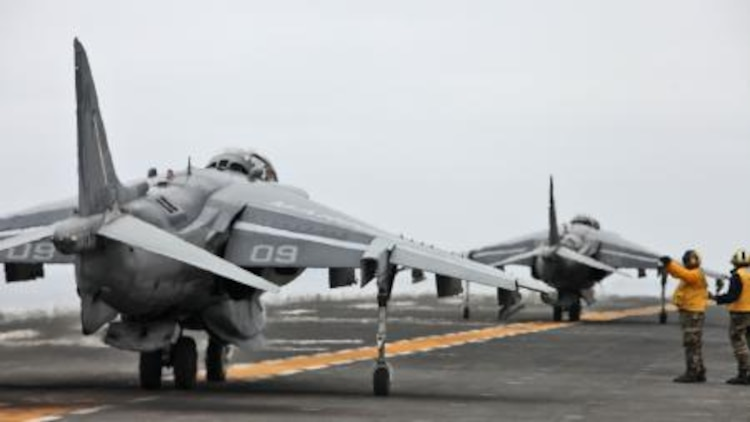 AV-8B Harriers prepare to takeoff from the flight deck of the USS Peleliu during daily flight operations as part of PHIBRON Three and 15th MEU's PHIBRON-MEU Interoperability Training off the coast of southern California, June 1. The purpose of the exercise is to give Marines and sailors the opportunity to become familiar working together as a blue-green team, a must when it comes to flight deck operations.::r::::n::::r::::n::::r::::n::