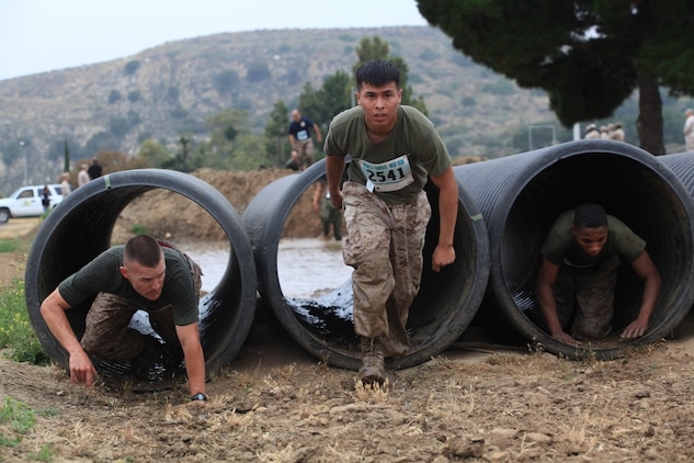 Determination is among Camp Pendleton Marines as they participate in the 2012 Hard Corps Race Series World Famous Mud Run near lake O'Neil, June 1. The Mud Run is a challenging 10K run with hills, tire obstacles, river crossings, two 5-foot walls with mud on both sides, tunnel crawl, slippery hill climb, and the final 30-foot mud pit.