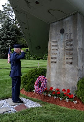 Col. Tony Gwosch places a wreath at the base of the F-100 Memorial commemorating fallen unit members during the F-100 Rededication Ceremony held at the 104th Fighter Wing on May 5, 2012.