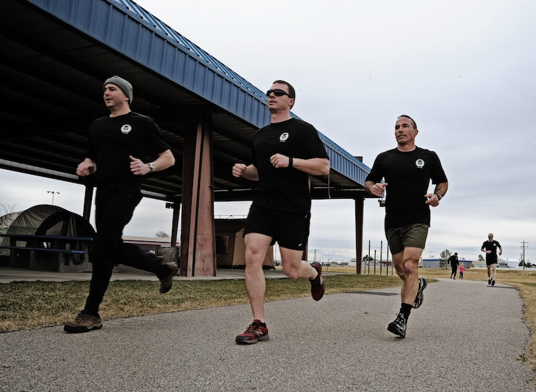 Maj. Shawn Scott, Tech. Sgt. Mark Andrews and Lt. Col. Tom Shuler from the 124th Air Support Operations Squadron of the Idaho Air National Guard run laps around the Gowen Field running track March 17. Beginning at 5 p.m. March 17 and lasting until 5 p.m. the following day, more than 30 Idaho ASOS members ran 270 miles to honor three ASOS Airmen who were killed in action during the month of March, including Maj. Greg Stone, a former Air Liaison Officer from the 124th ASOS who died March 25, 2003, in Kuwait. The 124th was one of several units from around the world to participate in the inaugural event.