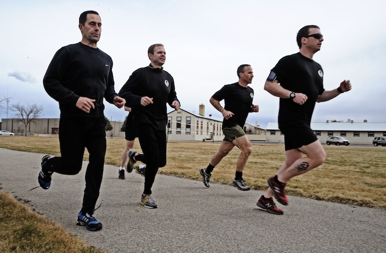 Members of the 124th Air Support Operations Squadron of the Idaho Air National Guard run laps around the Gowen Field running track March 17.  Beginning at 5 p.m. March 17 and lasting until 5 p.m. the following day, more than 30 Idaho ASOS members ran 270 miles to honor three ASOS Airmen who were killed in action during the month of March, including Maj. Greg Stone, a former Air Liaison Officer from the 124th ASOS who died March 25, 2003, in Kuwait. The 124th was one of several units from around the world to participate in the inaugural event.