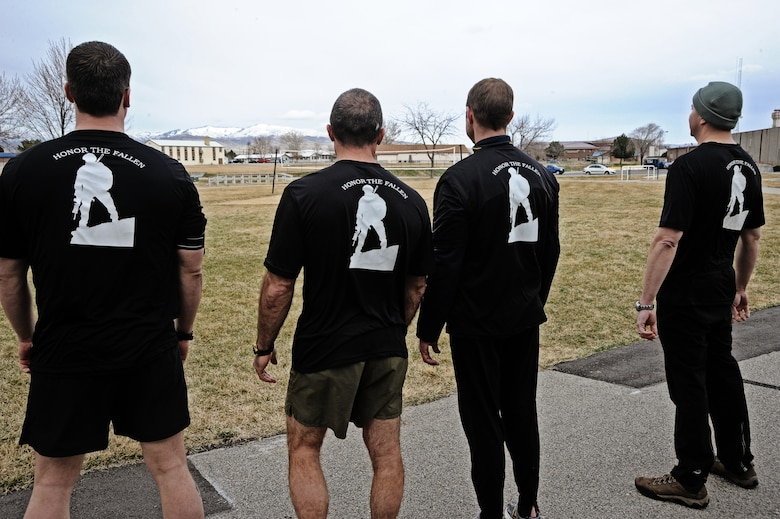Members of the 124th Air Support Operations Squadron of the Idaho Air National Guard prepare to run laps around the Gowen Field running track March 17. Beginning at 5 p.m. March 17 and lasting until 5 p.m. the following day, more than 30 Idaho ASOS members ran 270 miles to honor three ASOS airmen who were killed in action during the month of March, including Maj. Greg Stone, a former Air Liaison officer from the 124 ASOS who died March 25, 2003, in Kuwait. The 124th was one of several units from around the world to participate in the inaugural event.