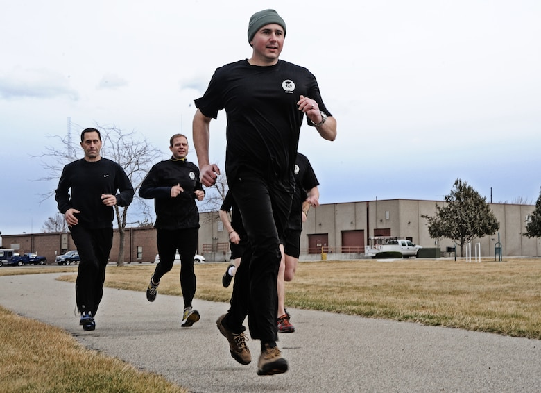 Maj. Shawn Scott, Air Liaison officer, and other members of the 124th Air Support Operations Squadron of the Idaho Air National Guard run laps around the Gowen Field running track March 17. Beginning at 5 p.m. March 17 and lasting until 5 p.m. the following day, more than 30 Idaho ASOS members ran 270 miles to honor three ASOS airmen who were killed in action during the month of March, including Maj. Greg Stone, a former Air Liaison Officer from the 124 ASOS who died March 25, 2003, in Kuwait. The 124th was one of several units from around the world to participate in the inaugural event.