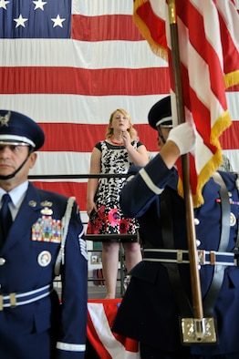 Rachel Hoferitza sings the national anthem at the opening ceremony of the 151st Air Refueling Wing's 2012 Airman Appreciation Day at the Utah Air National Guard base in Salt Lake City, June 2 2012.  (U.S. Air Force Photo by Tech. Sgt. Jeremy Giacoletto-Stegall/Released)