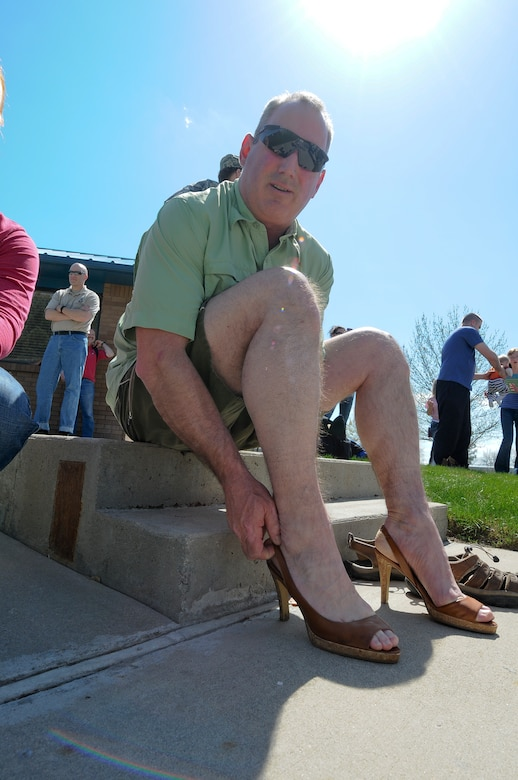 Senior Master Sgt. Steve White of the 124th Medical Group tries on his new footware in preparation for the Walk a Mile in Her Shoes event April 20 at Gowen Field, Boise, Idaho. The event was held in recognition of Sexual Assault Awareness month.