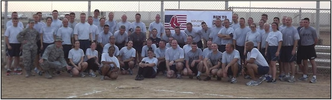 On May 20th, members of the deployed aviation package, stationed at an undisclosed location in the Middle East, participated in a simultaneous 'Run for Home Base', along side the rest of Red Sox Nation...the only difference was the 131 Air Expeditionary Squadron runners didn't enjoy the cool spring Boston air, they battled 90 degree temperatures at 4:30 in the morning as they ran around their military base, finishing on the home plate of a dust covered softball field.