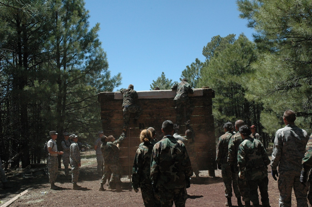 Junior ROTC cadets climb over one of the ostacles during the Senior Leadership School May 26 to June 1 at Camp Navajo, Flagstaff, Ariz. In addition to the obstacle course, cadets performed exercises in land navigation, drill and ceremony, academics, and mental and psychological tests. (U.S. Air Force photo by 2nd Lt. Rebecca Garcia/released)