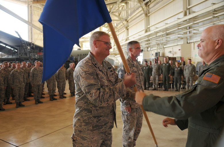 Charlotte, N.C. -- Lt. Col. Marshall Collins accepts command of the 145th Maintenance Group from Brig. Gen. Tony McMillan at the change of command ceremony June 2, 2012. (U.S. Air Force photo by Tech. Sgt. Brian E. Christiansen)