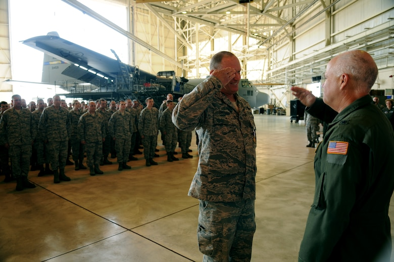 Charlotte, N.C. -- Col David Zartman, outgoing commander of the 145th Maintenance Group (left) salutes Brig. Gen. Tony McMillan at the conclusion of the change of command ceremony on June 2nd, 2012.   (U.S. Air Force photo by Tech. Sgt. Brian E. Christiansen)