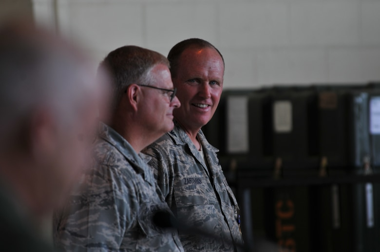 Charlotte, N.C. -- Col David Zartman listens to Brig Gen Tony McMillan talk about the 145th Maintenance Group before the change of command June 2, 2012. (U.S. Air Force photo by Tech. Sgt. Brian E. Christiansen)
