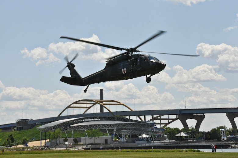 A UH-60 Black Hawk Helicopter from the Army Aviation Supply Facility #1, West Bend, Wis., prepares to land at the training grounds near Lake Michigan, Wis., before conducting water rescue training maneuvers with members of the 128th Air Refueling Wing, Milwaukee on Saturday, June 2, 2012.  The water survival and extraction training was a joint exercise with support from the 128 ARW, UH-60 Black Hawk Helicopters, Coast Guard, and Milwaukee Fire Dept.   U.S. Air Force Photo by: Staff Sgt. Jeremy M. Wilson