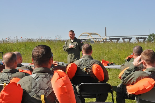Master Sgt. Adam Becker, Aircrew Flight Equipment, 128th Air Refueling Wing, Milwaukee, conducts a safety briefing for pilots and boom operators before entering Lake Michigan, Wis., for water survival and extraction training on Sat., June 2, 2012.  The training conducted was a joint exercise with support from the 128 ARW, UH-60 Black Hawk Helicopters from the Army Aviation Support Facility #1, West Bend, Wis., Coast Guard, and Milwaukee Fire Dept.  U.S. Air Force Photo by: Staff Sgt. Jeremy M. Wilson
