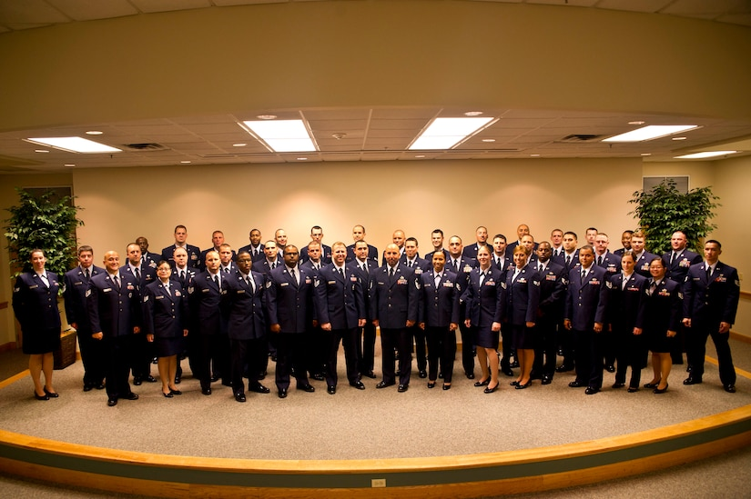 Community College of the Air Force graduates pose for a group photo at the Education Center on Joint Base Charleston - Air Base, S.C., May 31, 2012. Forty-eight Airmen attended the graduation for their diplomas, however more than 150 Airmen graduated and received their CCAF degree. (U.S. Air Force photo by Airman 1st Class George Goslin)