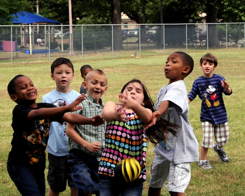 Children attending the Barksdale Youth Center summer camp attempt to catch a ball during recess on Barksdale Air Force Base, La., May 31. The camp offers a variety of activities such as science projects, arts and crafts, field trips, life skills and a reading program. (U.S. Air Force photo/Senior Airman La'Shanette V. Garrett)(RELEASED)