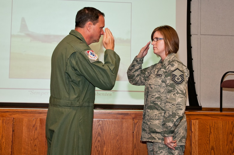 Col. Michael Pankau, 139th Airlift Wing commander, salutes Master Sgt. Heidi Utt for stopping a woman from possibly jumping to her death in an apparent suicide attempt May 24, 2012. (Air National Guard photo by Senior Airman Sheldon Thompson/Released)