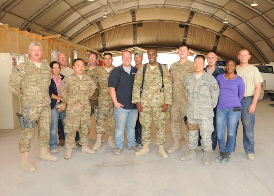 Master Sgt. Stephen Charles, 451st Air Expeditionary Wing ground safety manager, and 451st Air Expeditionary Wing Vehicle Operations and Maintenance personnel, pose for a group photo here at Kandahar Airfield, Afghanistan, May 23, 2012. Charles has worked extensively with the personnel and helped them with their various safety issues. (U.S. Air Force photo/Staff Sgt. Heather Skinkle)