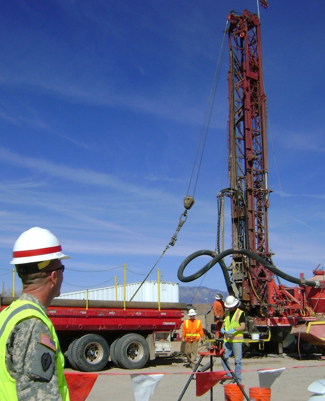 Lt. Col. Williams observed the progress of the well drilling on Kirtland Mar. 1.
