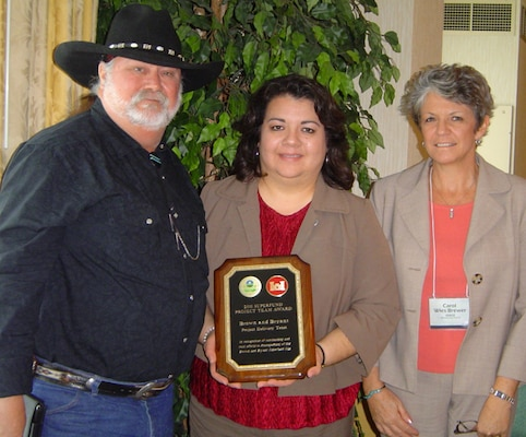 Accepting the award for the team was Rick Lainhart from the Los Angeles District, Cecilia Horner (middle) and Carol Wies-Brewer, both from the Albuquerque District.