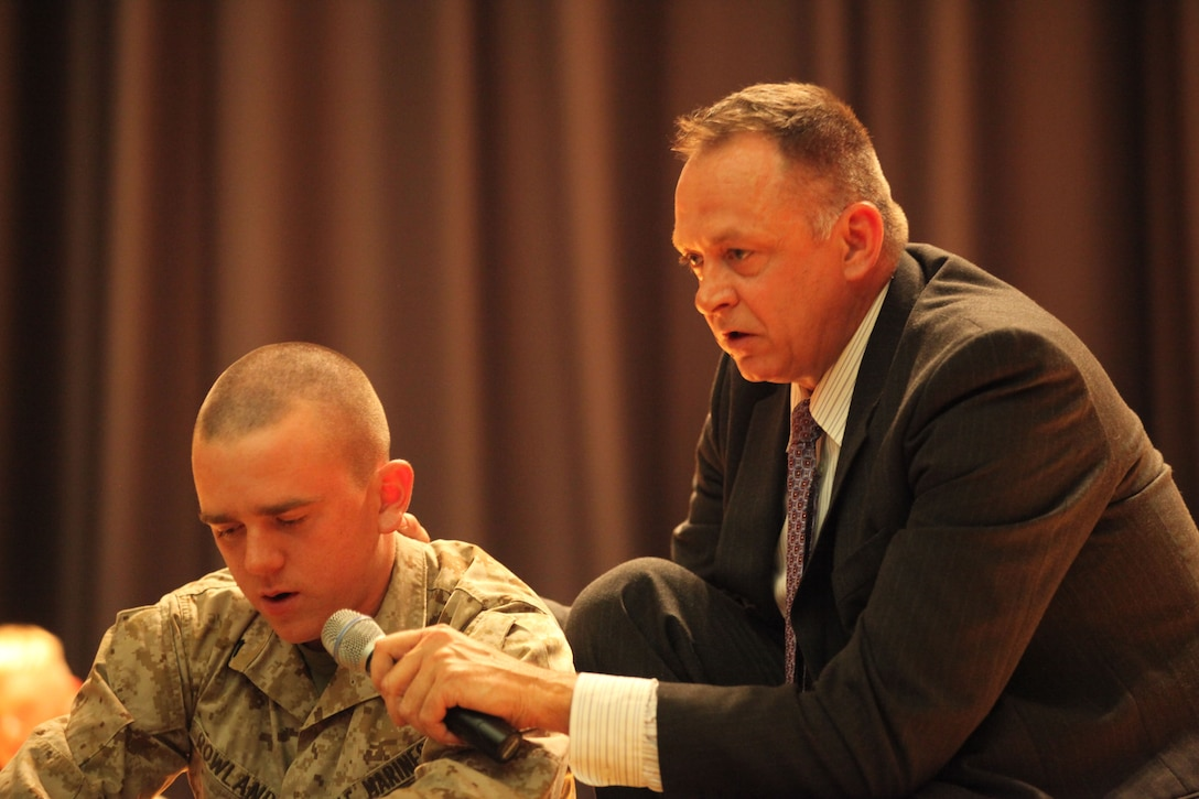 Bryan McDaniel talks to one of the Marines who was hypnotized  during a drunk driving demonstration at a stage hypnosis show aboard Marine Corps Base Camp Lejeune, May 22. McDaniels asked the Marine about his family and his home after a imaginary car crash.