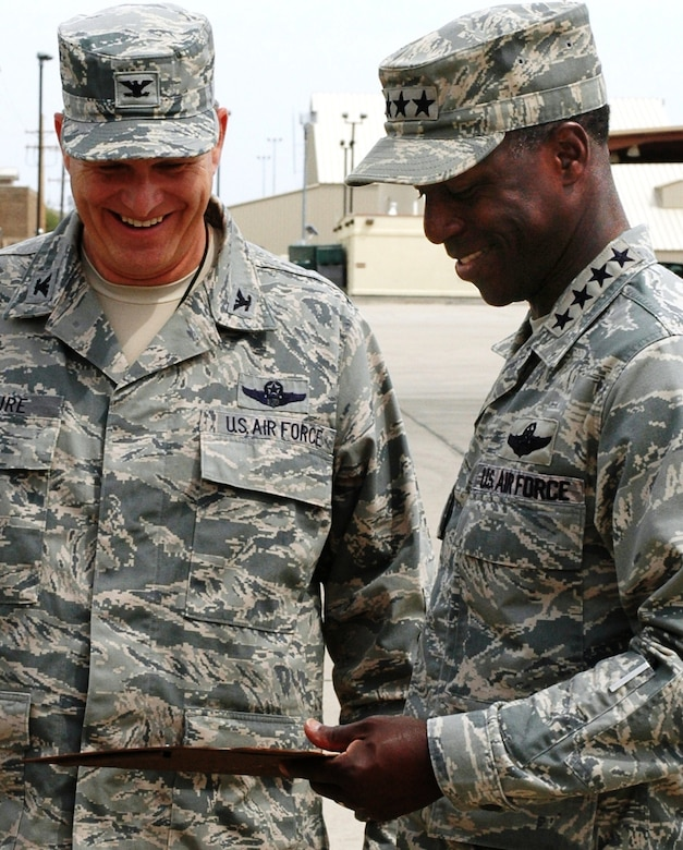 U.S. Air Force Gen. Edward A. Rice Jr., commander of Air Education and Training Command, accepts a memento from 162nd Fighter Wing Commander Col. Mick McGuire after his visit to the Arizona Air National Guard's F-16 Fighting Falcon training unit at Tucson International Airport. Rice visited the unit to observe activities during the June Unit Training Assembly.  (U.S. Air Force photo by 1st Lt. Angela Walz)